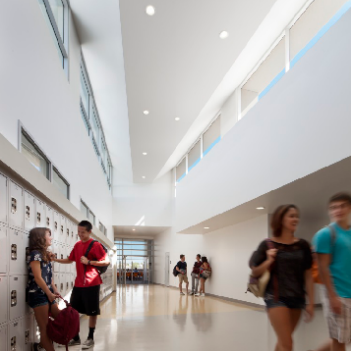an image of students walking down a hall